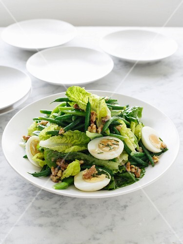 Green bean salad with hard-boiled eggs and walnuts