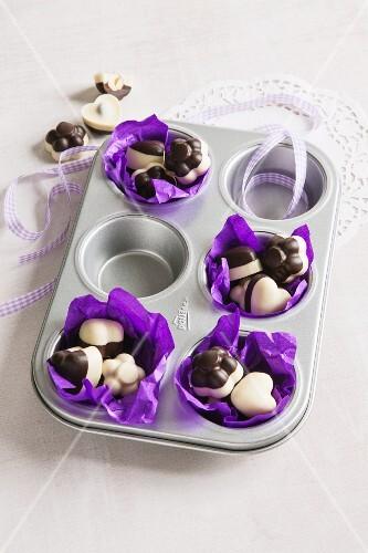 Hazelnuts with chocolate glaze in a muffin tin