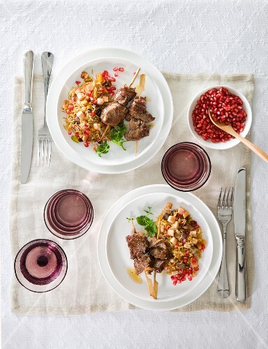 Lamb kebabs with rice and pomegranate seeds