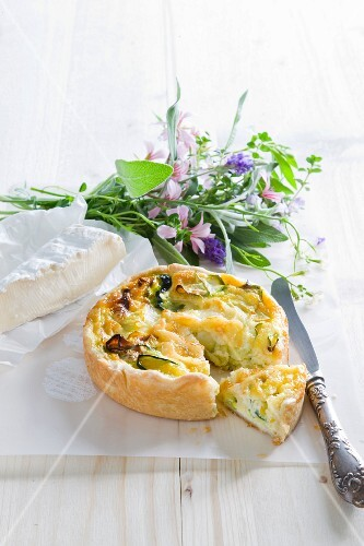 Courgette quiche, brie and a bunch of herbs