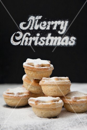 Mince pies, with 'Merry Christmas' written in the background