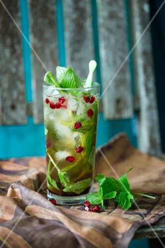 Ginger beer cocktail with mint and pomegranate