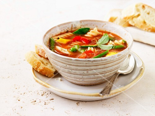 Tomato soup with vegetables and fusilli pasta