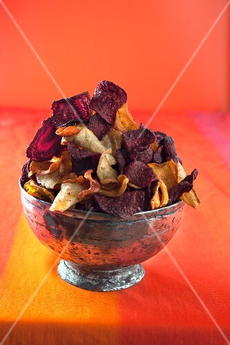 Assorted vegetable crisps in a silver bowl