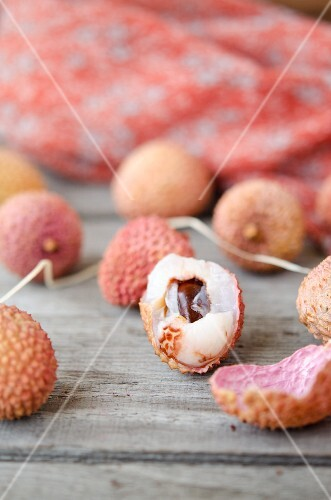 Lychees on a wooden table