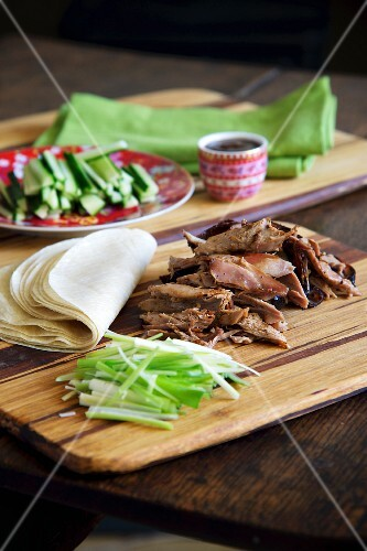 Fried duck with vegetables and pancakes