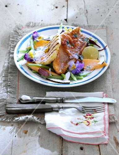 Bean salad with grilled pineapple, mango and a fillet of red mullet wrapped in dry-cured ham