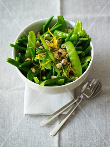Mange tout salad with orange zest and hazelnuts