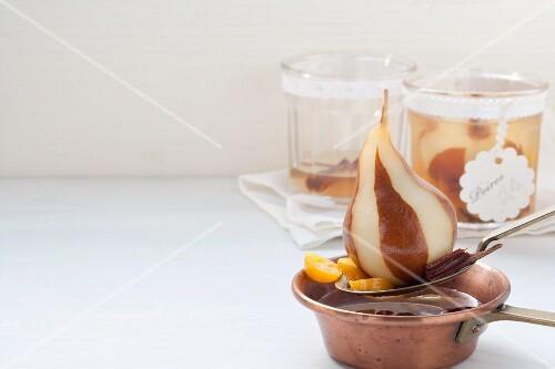 Pears in white wine with kumquats