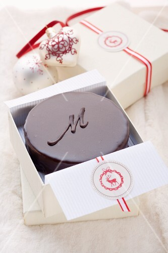 A small Sachertorte (rich chocolate cake from Austria) as a gift