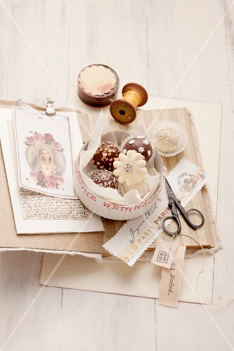 Petits fours in a box with nostalgic writing materials