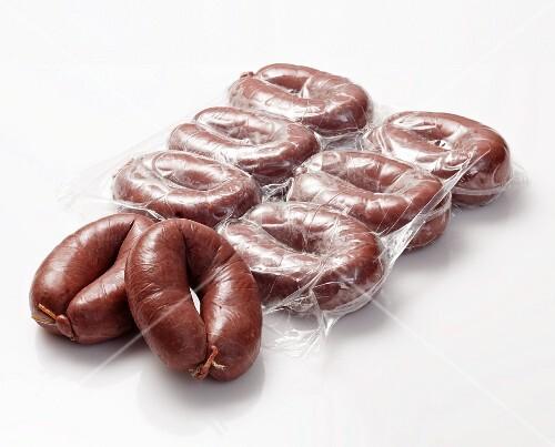 Grützwurst (German blood sausage), partly in the packet