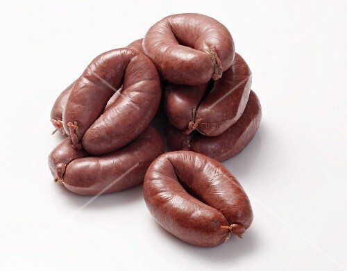 Several Grützwurst (blood sausages from Germany), stacked