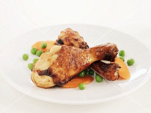 Chicken drumsticks with peas and carrots