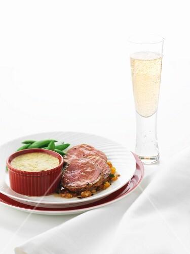 Lamb fillet with sugar snap peas and potato gratin