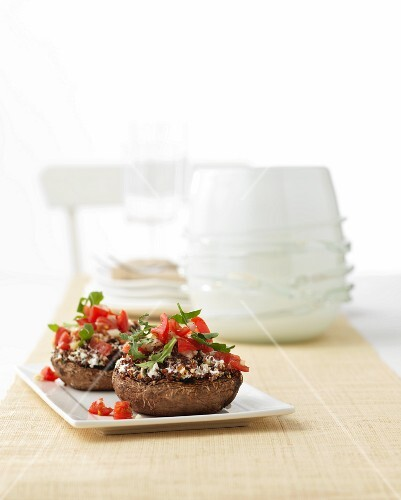 Stuffed mushrooms with tomatoes and rocket