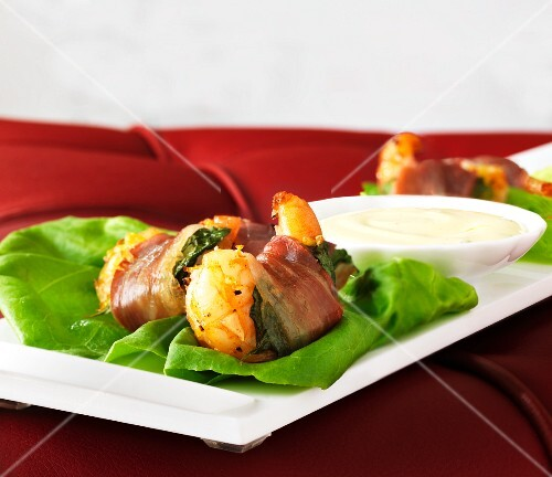 Prawns wrapped in Serrano ham