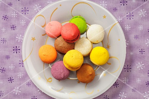Colourful macaroons on a plate (Christmassy)