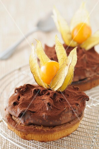 Sable biscuits topped with ganache and physalis