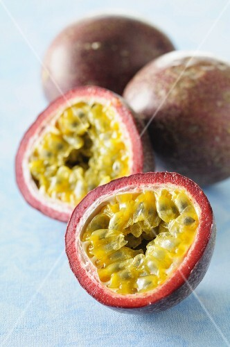 Purple passion fruits, whole and halved