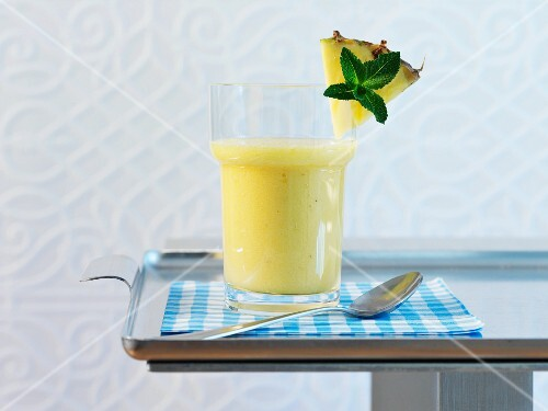 A glass of pineapple and banana smoothie