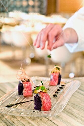 Chef Garnishing Waygu Beef