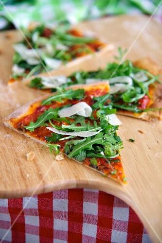 Rocket pizza cut into slices