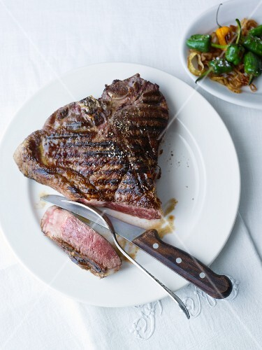 Barbecued T-bone steak with fried onions