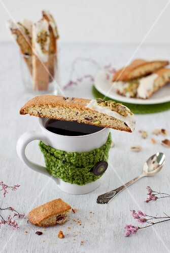 Orange Biscotti with Pistachios on a Cup of Coffee