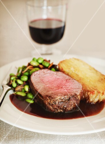 Beef steak in red wine sauce with beans
