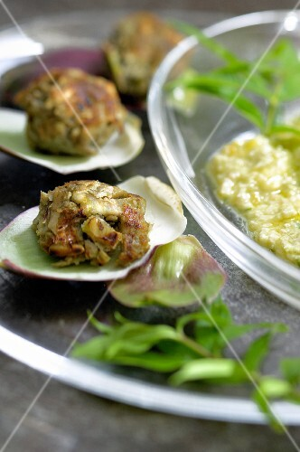 Artichoke balls with lemon and pine nut sauce