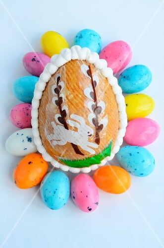 A crispy egg surrounded by colourful miniature eggs