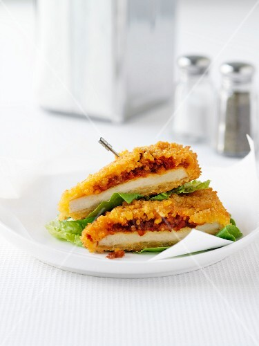 Chicken breast topped with a mixture of tomatoes and peppers and then coated in breadcrumbs
