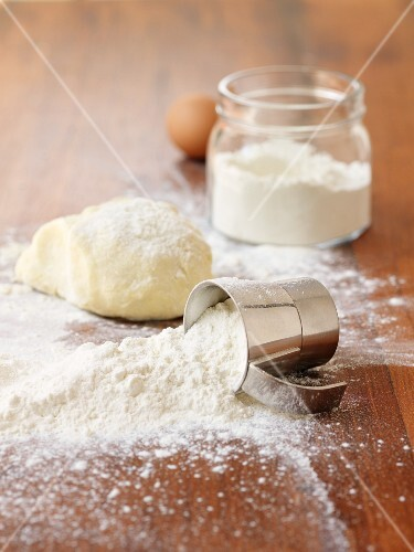 Flour and dough on a wooden surface