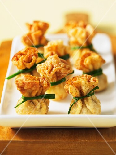 Wontons tied with chives