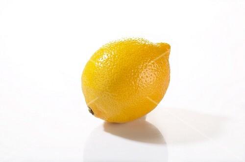 A lemon on a white surface