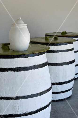 Olive oil in casks and in a white pitcher (Tunisia)