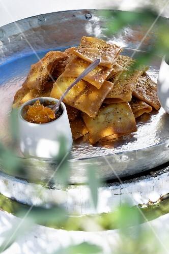 Deep-fried semolina squares with orange marmalade (Tunisia)