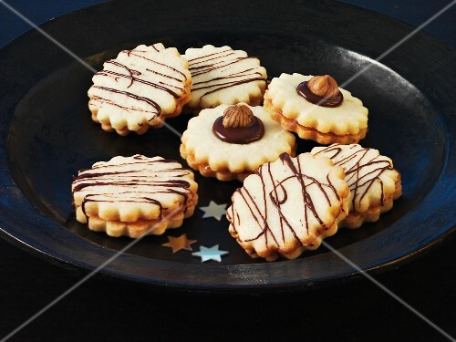 Christmas biscuits with chocolate stripes and hazelnuts