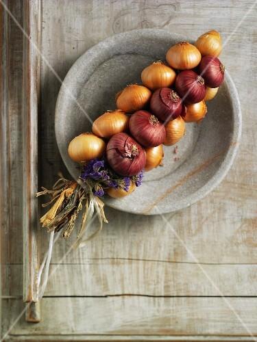 An onion plait in a stone bowl