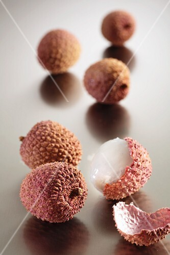 A few lychees, whole and cut open