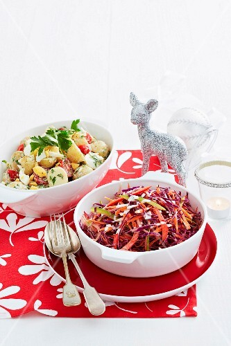 Colourful coleslaw and potato salad with tomato and egg