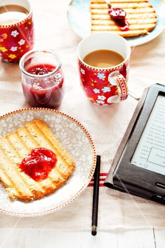 Toast with jam and a cup of coffee