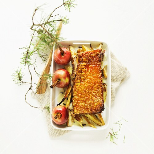 Crispy Christmas roast with apples and root vegetables