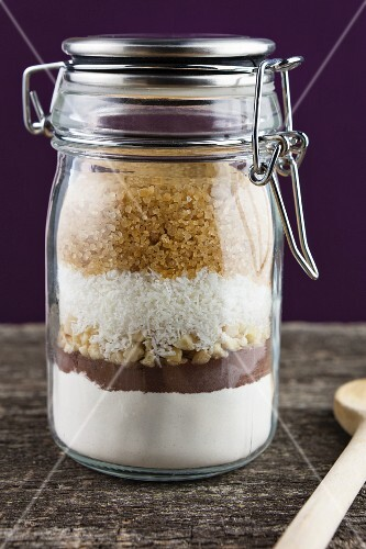 A preserving jar containing the dry ingredients for making coconut and nut biscuits