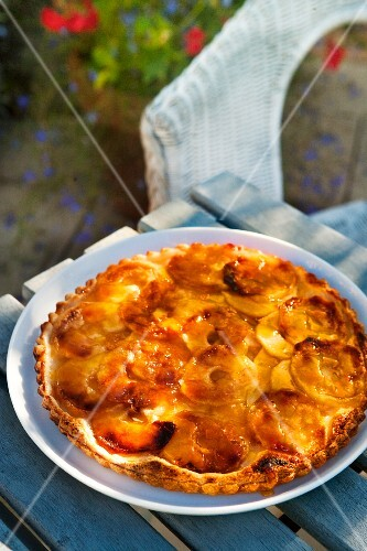 An apple puff pastry tart on a garden table