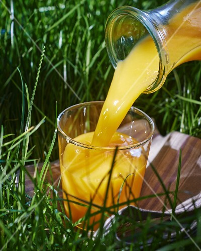 Orange juice being poured into a glass