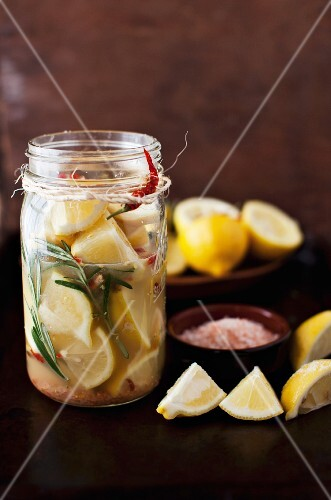 Preserved Lemons with Rosemary and Chili Peppers in a Jar