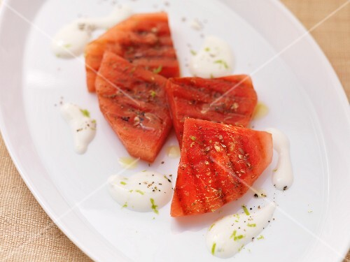 Barbecued watermelon slices with a lime sauce