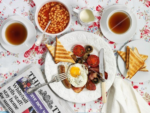 Full English breakfast including bacon, fried egg, toast, baked beans and a cup of tea